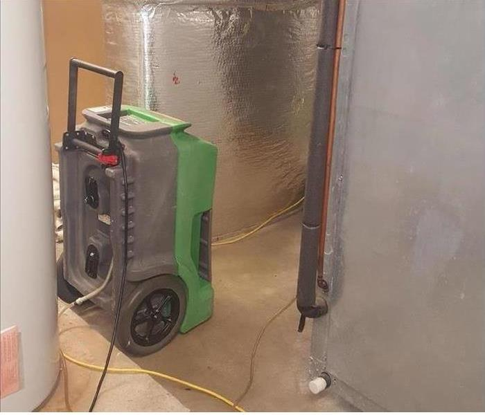 SERVPRO equipment restoring water damage from pipe break
