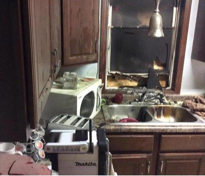 Fire damaged kitchen before SERVPRO
